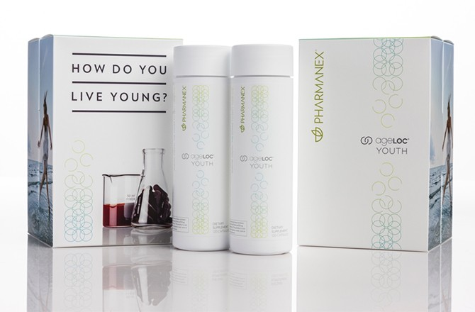 Nu Skin Pharmanex AgeLoc Youth product bottles and boxes on display.
