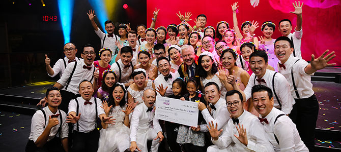 Korea Nu Skin Sales Leaders pose for a picture as they are given a giant check to their Nu Skin charity of choice as their prize for winning Nu Skin's Got Talent.