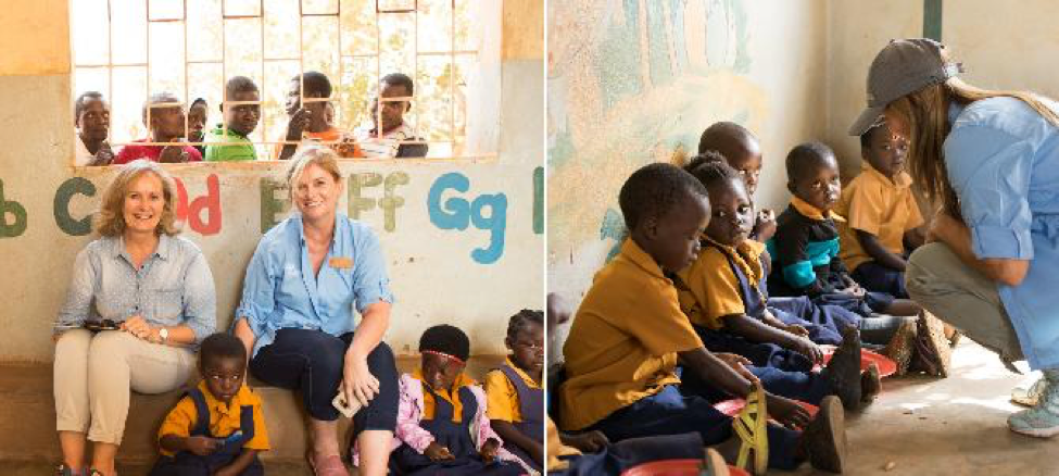 Nu Skin employees pose for a picture with children at a community-based child care center in Malawi.