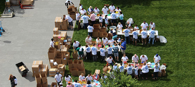 Nu Skin employees assemble back-to-school kits during the 2017 Force for Good day celebration.